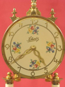 The painted dial with brass chapter ring (numerals) and brass hands.