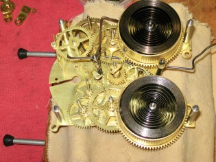 The mainspring barrwls with the covers removed