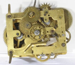 """Front of Alternating movement. The brass repeat spring is fastened by the lower left pillar screw and extends to the right. The 3rd wheel cam raises the spring's middle bent down end. Its bent down right end stops the """"hammer lock"""" on the alarm hammer."""