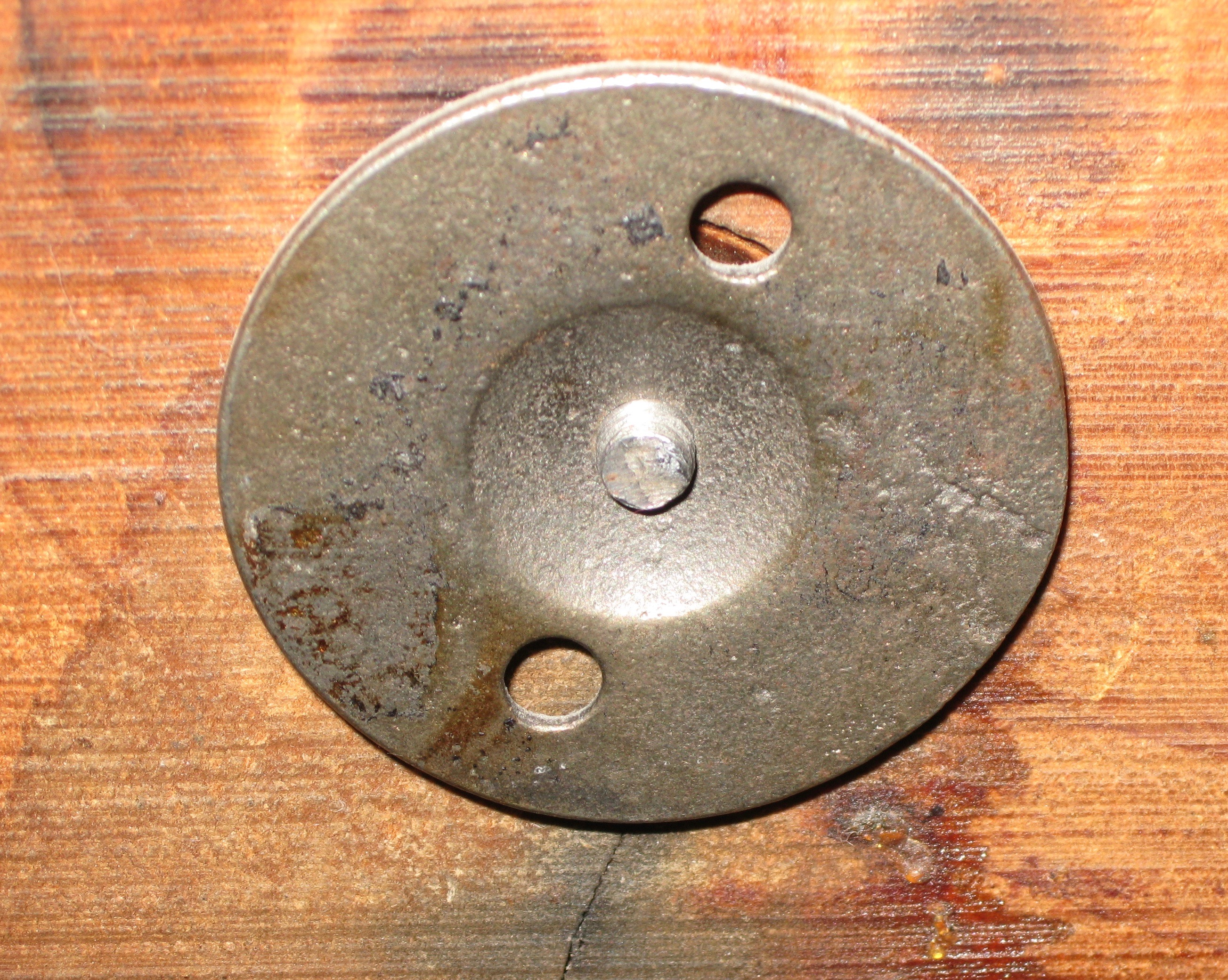 Iron flange outside the back that secures the gong.
