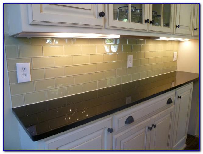 Cream Cabinets White Subway Tile Backsplash