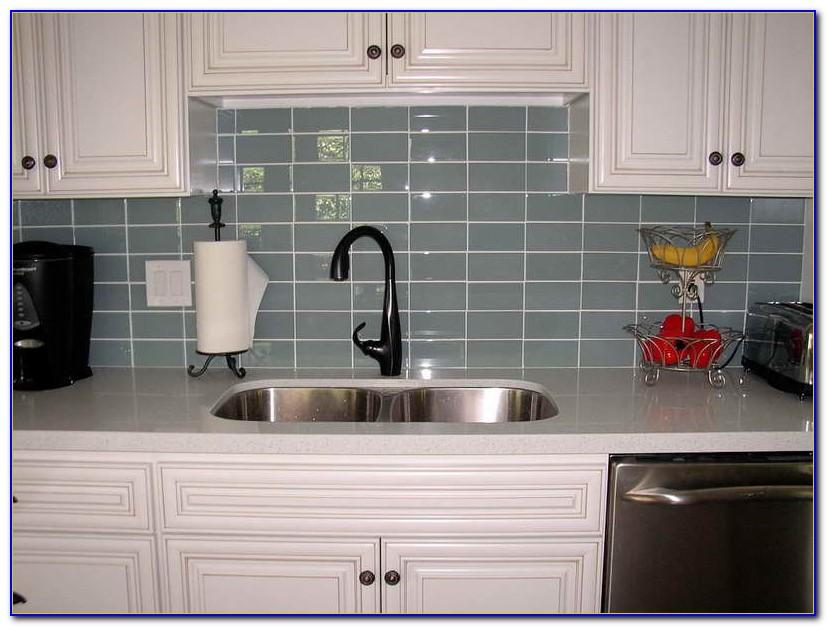 Grey Subway Tile Backsplash With Dark Cabinets