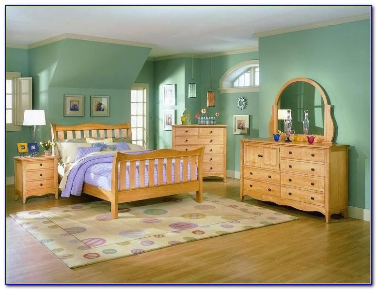 Light Wood Canopy Bedroom Sets
