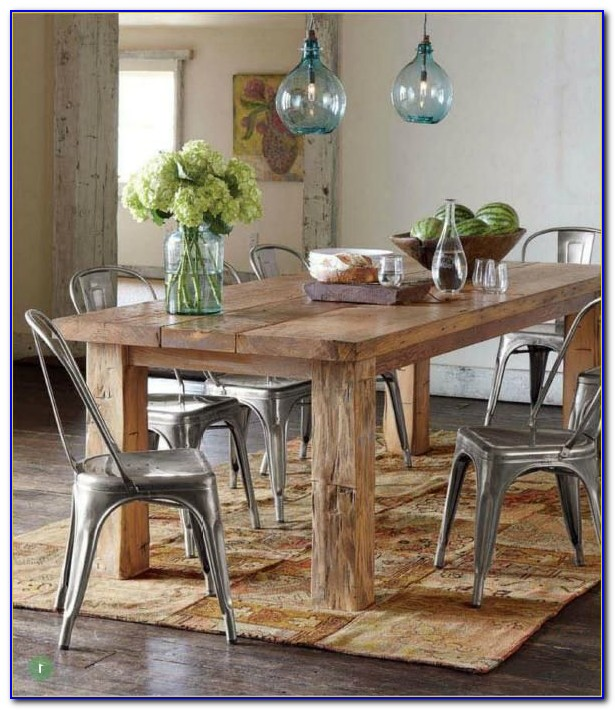 Farmhouse Table With White Metal Chairs