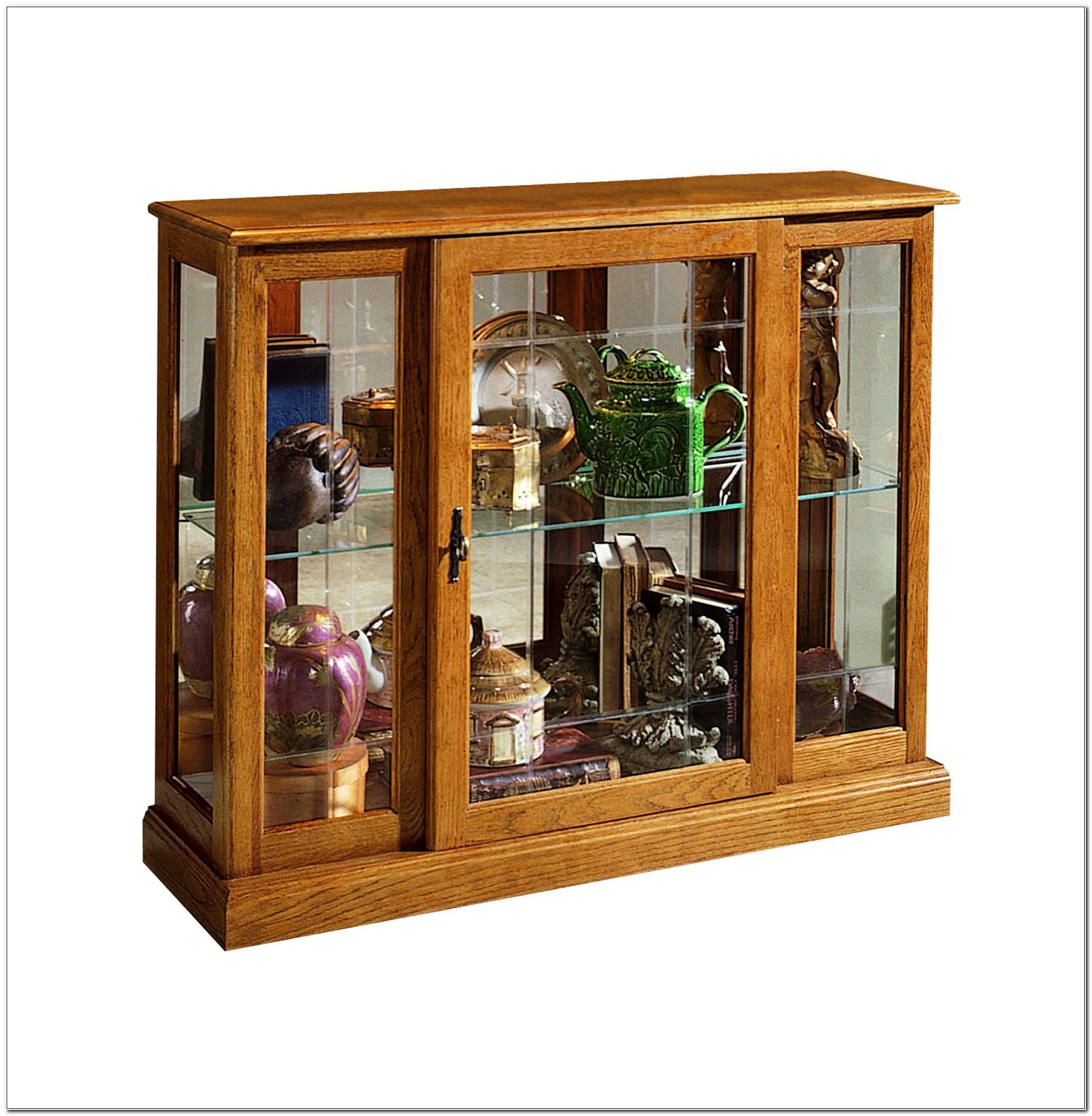 Pulaski Golden Oak Console Curio Cabinet