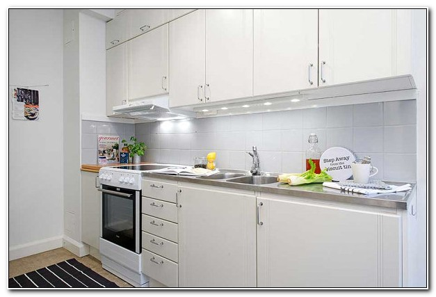 Stainless Steel Countertops And White Cabinets