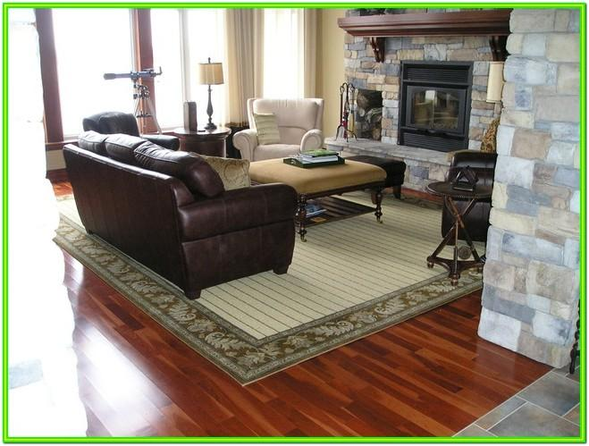Area Rug On Carpet In Living Room