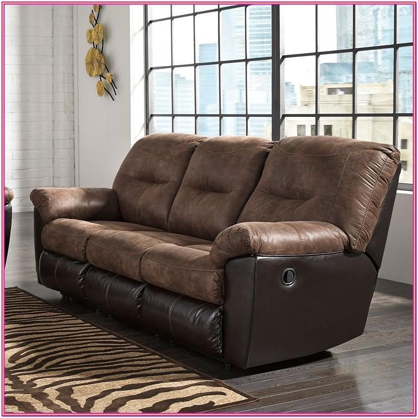 Follett Coffee Reclining Living Room Set By Ashley