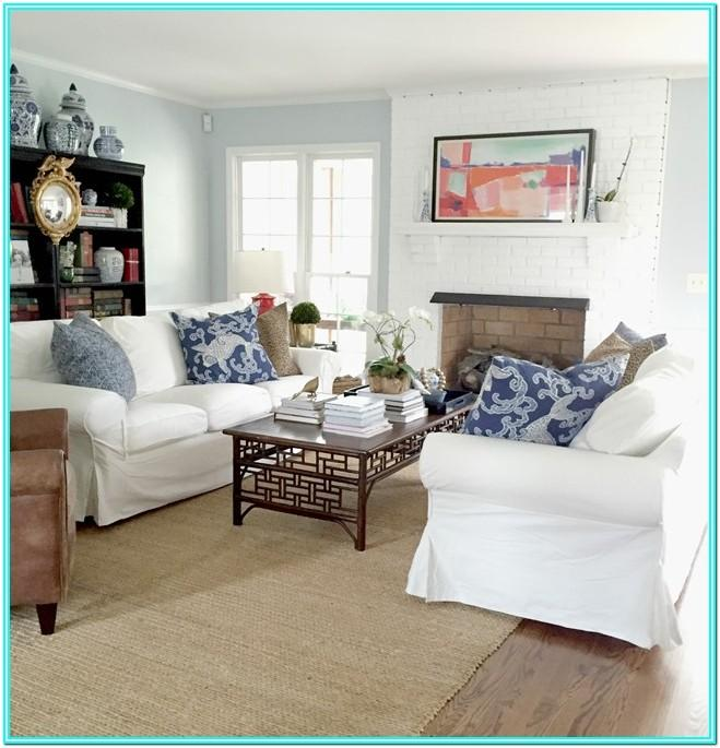 Living Room With One Couch And Two Chairs