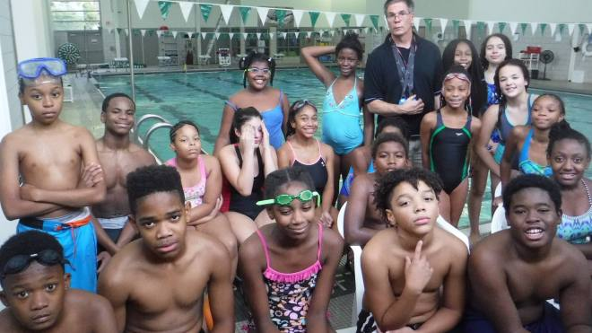 Group photo of Obama MS water polo players and coach in fall 2016