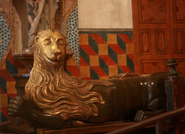 Gold Lion solar symbol statue in San Xavier del bac mission