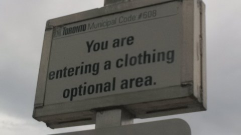 Entering clothing optional area sign