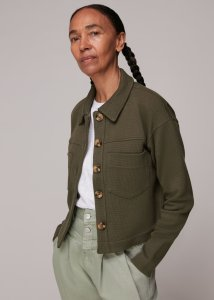Woman in green cropped jacket