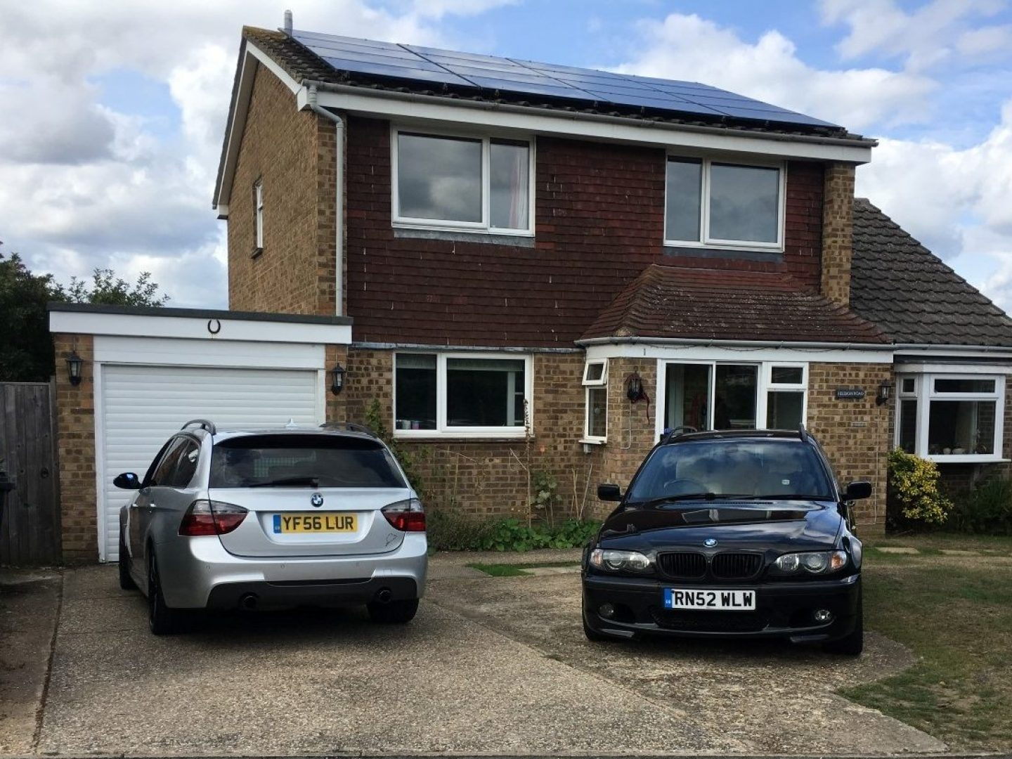 335d and 330d in front of house