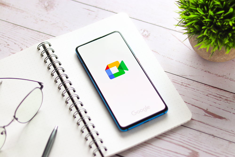 Picture of a phone with Google Meet displayed.