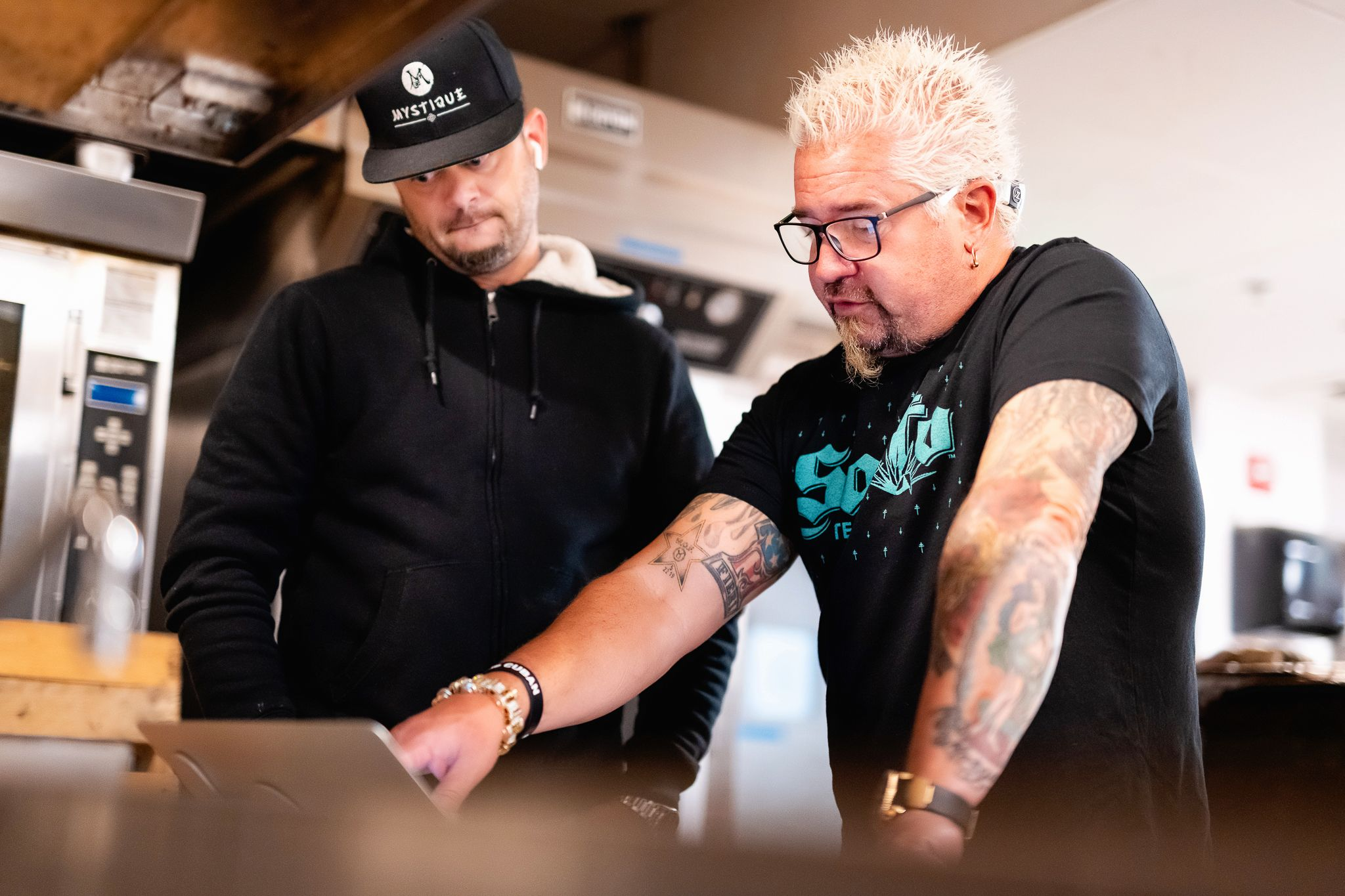 Guy Fieri chats with the chef at Guy Fieri's Tequila Cocina.