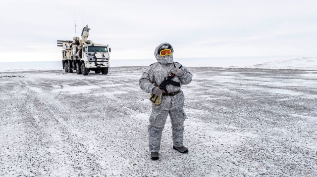 A soldier holds a machine gun as he patrols the Russian northern military base on Kotelny island, beyond the Arctic circle on April 3, 2019. The Arctic is a strategic region for Russia as it continues to strengthen its presence with the new perspectives offered by global warming. (Maxime Popov/AFP via Getty Images)