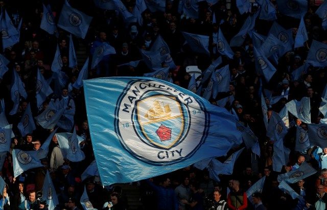 "Soccer Football - Carabao Cup Final - Aston Villa v Manchester City - Wembley Stadium, London, Britain - March 1, 2020  Manchester City fans wave flags before the match   Action Images via Reuters/Lee Smith  EDITORIAL USE ONLY. No use with unauthorized audio, video, data, fixture lists, club/league logos or ""live"" services. Online in-match use limited to 75 images, no video emulation. No use in betting, games or single club/league/player publications.  Please contact your account representative for further details."