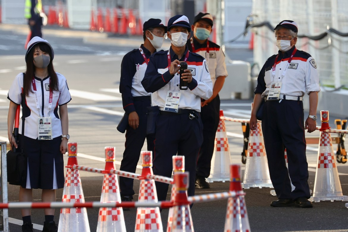 Security staff stand guard at the entrance of the Athletes Village, where a person has tested positive for COVID-19, ahead of Tokyo 2020 Olympic Games in Tokyo, Japan July 17,  2021. REUTERS/Kim Kyung-Hoon