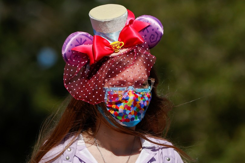 A person is seen outside Disneyland Park on its reopening day amidst the coronavirus disease (COVID-19) outbreak, in Anaheim, California, U.S., April 30, 2021. REUTERS/Mario Anzuoni