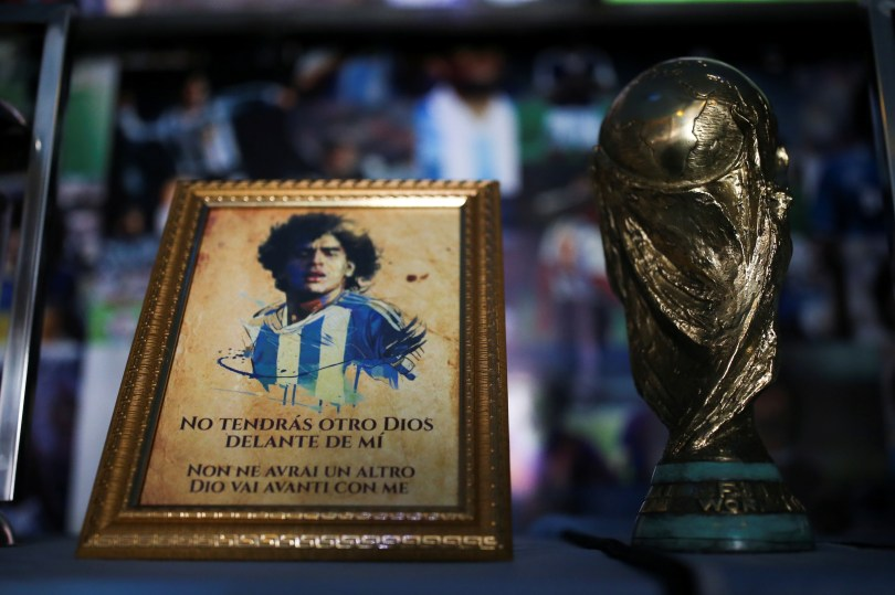 A picture of Diego Maradona and a replica of the World Cup trophy are pictured on an altar at the first Mexico's church in memory of soccer legend Diego Armando Maradona in San Andres Cholula, in Puebla state, Mexico July 14, 2021. Picture taken July 14, 2021. REUTERS/Edgard Garrido