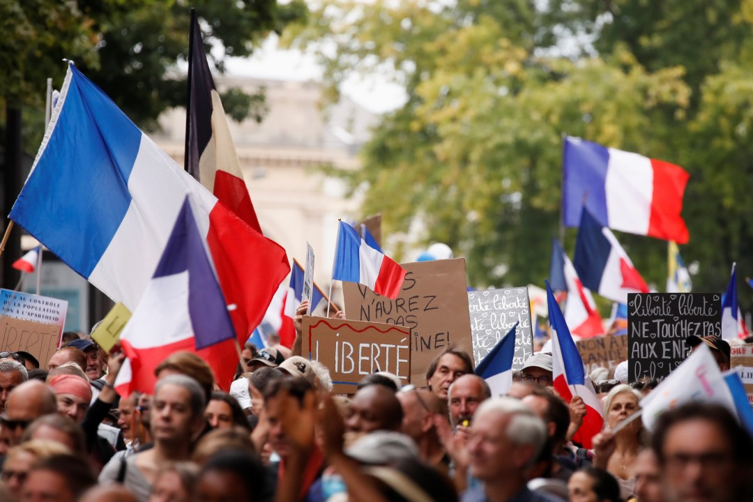 Protesters attend a demonstration against France's restrictions, including a compulsory health pass, to fight the coronavirus disease (COVID-19) outbreak, in Paris, France, August 21, 2021. REUTERS/Christian Hartmann