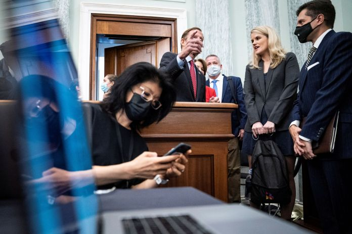Former Facebook employee and whistleblower Frances Haugen speaks with Sen. Richard Blumenthal (D-CT) during a Senate Committee on Commerce, Science, and Transportation hearing entitled 'Protecting Kids Online: Testimony from a Facebook Whistleblower' on Capitol Hill, in Washington, U.S., October 5, 2021.  Jabin Botsford/Pool via REUTERS