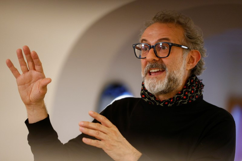 Michelin-starred chef Massimo Bottura gestures as he speaks during an interview with Reuters at Ferrari's restaurant 'Cavallino' in Maranello, Italy, June 8, 2021. Picture taken June 8, 2021. REUTERS/Guglielmo Mangiapane