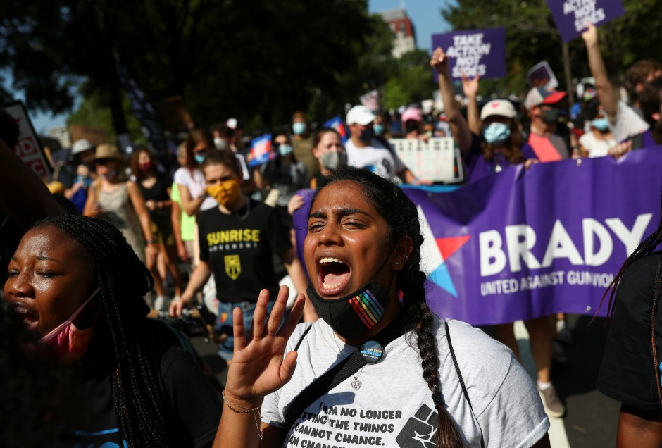 A demonstrator shouts slogans at an anti voter suppression laws march near the White House, Washington, U.S., August 28, 2021. REUTERS/Tom Brenner