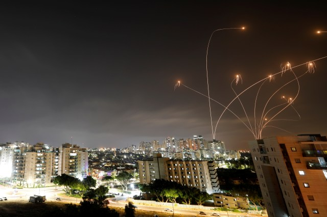 Streaks of light are seen as Israel's Iron Dome anti-missile system intercepts rockets launched from the Gaza Strip towards Israel, as seen from Ashkelon, Israel May 10, 2021. REUTERS/Amir Cohen