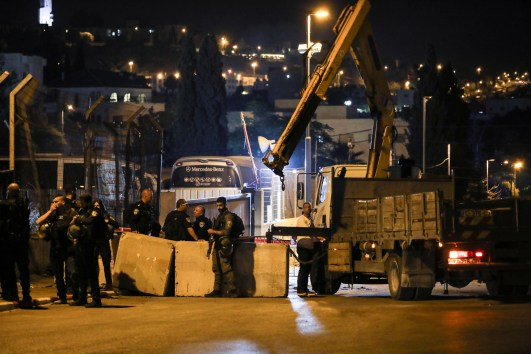 Israel forces place cement blocks at the entrance of Sheikh Jarrah neighbourhood of East Jerusalem May 16, 2021. REUTERS/Ammar Awad
