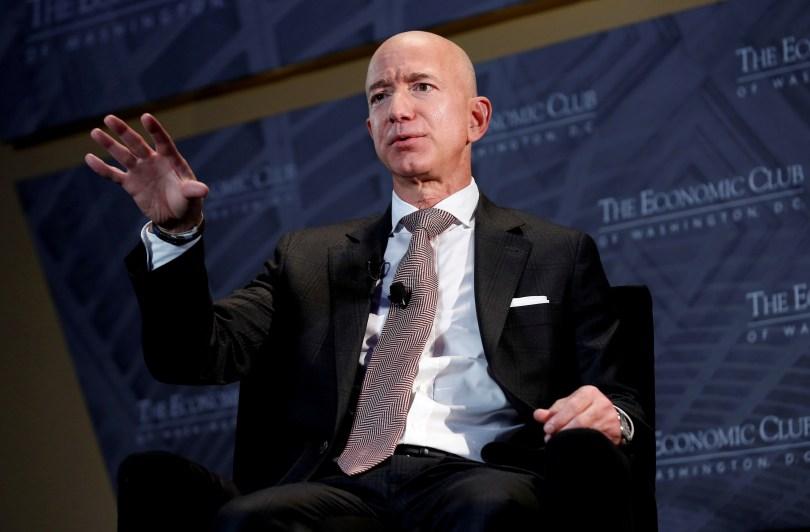 "Jeff Bezos, president and CEO of Amazon and owner of The Washington Post, speaks at the Economic Club of Washington DC's ""Milestone Celebration Dinner"" in Washington, U.S., September 13, 2018. REUTERS/Joshua Roberts/File Photo"