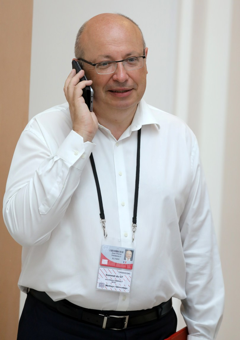 French Ambassador in charge of the G7 summit preparations Jean-Pierre Thebault speaks on his mobile phone while working in Biarritz, France August 25, 2019. Ludovic Marin/Pool via REUTERS