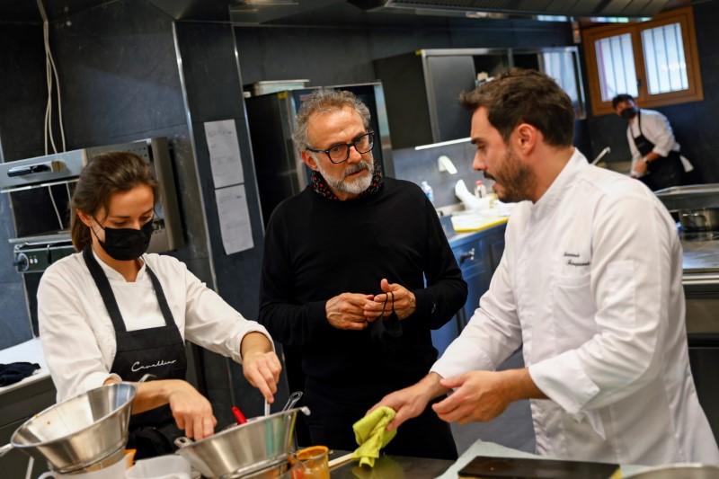 Michelin-starred chef Massimo Bottura speaks with chef Riccardo Forapani at Ferrari's restaurant 'Cavallino' in Maranello, Italy, June 8, 2021. Picture taken June 8, 2021. REUTERS/Guglielmo Mangiapane