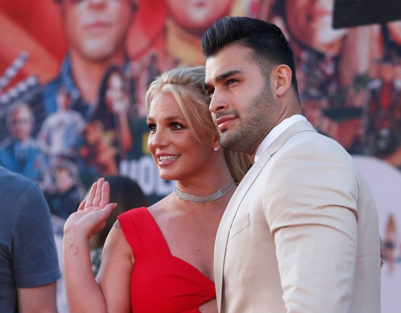 """Britney Spears and Sam Asghari pose at the premiere of """"Once Upon a Time In Hollywood"""" in Los Angeles, California, U.S., July 22, 2019. REUTERS/Mario Anzuoni"""