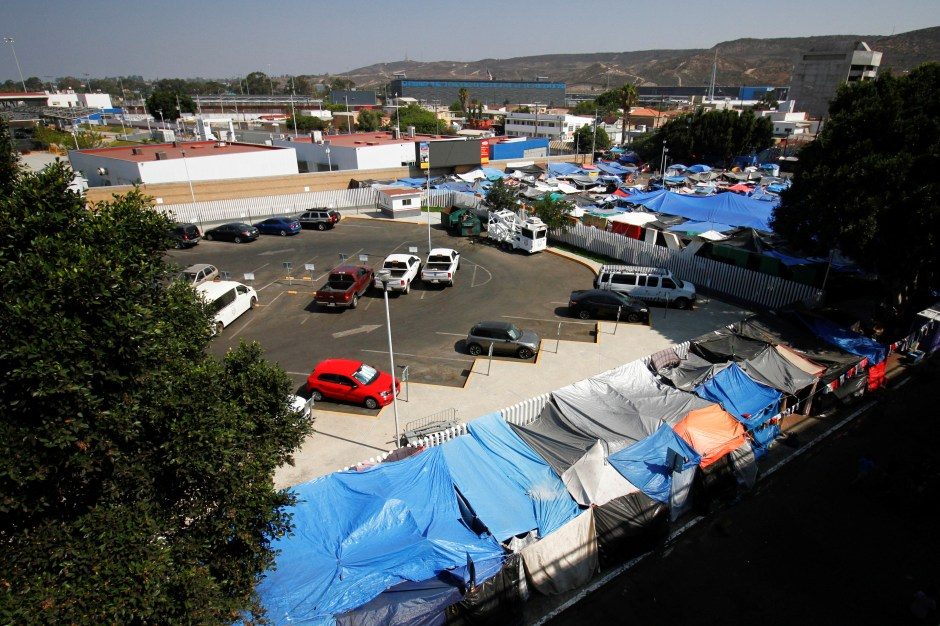 A general view shows a migrant makeshift camp after the U.S. Supreme Court ordered to uphold an immigration policy implemented under former President Donald Trump that forced thousands of asylum seekers to stay in Mexico to await U.S. hearings, at El Chaparral crossing port with the U.S., in Tijuana, Mexico August 25, 2021. REUTERS/Jorge Duenes