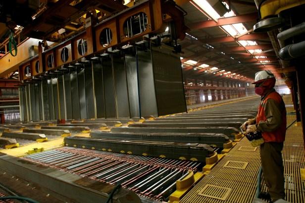 A worker from BHP Billiton's Escondida, the world's biggest copper mine, is pictured inside a copper cathodes plant in Antofagasta, Chile March 31, 2008. REUTERS/Ivan Alvarado