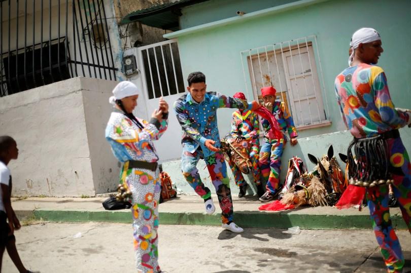 "A member of Venezuelan brotherhood ""Dancing Devils"" dances during their annual Corpus Christi celebration with a call for the end of the coronavirus disease (COVID-19), in Naiguata, Venezuela June 3, 2021. REUTERS/Leonardo Fernandez Viloria/File Photo"