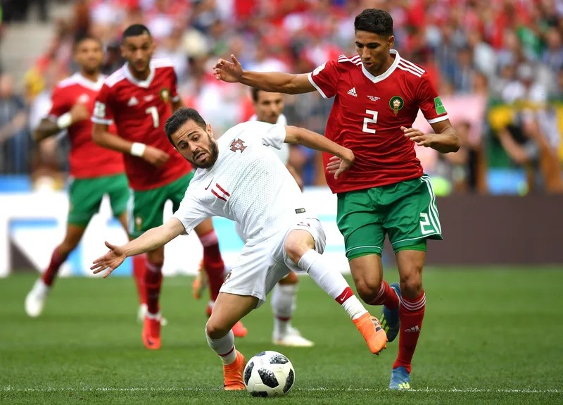 MOSCOW, RUSSIA - JUNE 20:  Bernardo Silva of Portugal challenge for the ball with Achraf Hakimi of Morocco during the 2018 FIFA World Cup Russia group B match between Portugal and Morocco at Luzhniki Stadium on June 20, 2018 in Moscow, Russia.  (Photo by Stuart Franklin - FIFA/FIFA via Getty Images)