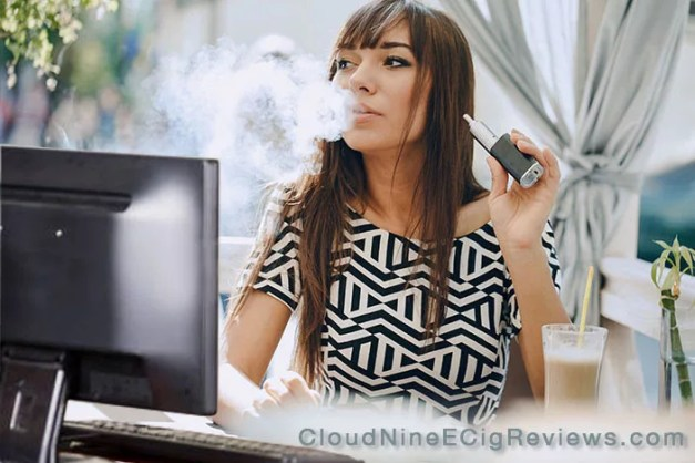 Woman vaping at computer 0 CloudNineEcigReviews