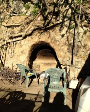 The outside hearth he's carved out of the rock face (former sea cliffs)