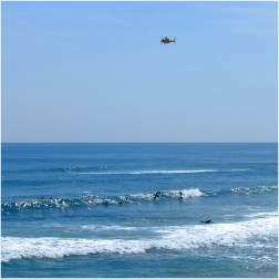 The Westpac Lifesaver helicopter clearing the surfers from the sea