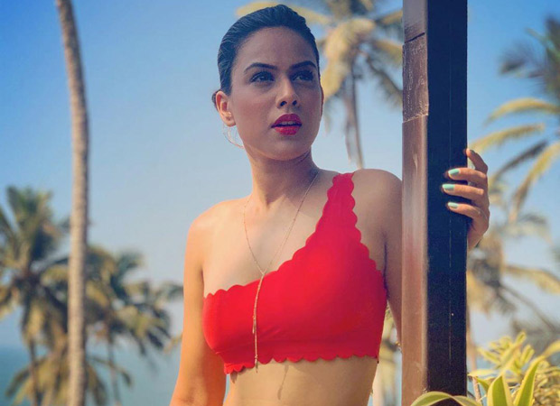 HOT ALERT Nia Sharma rocks in a red BIKINI on New Yearu2019s Eve