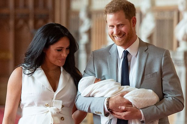 Prince Harry and the Duchess of Sussex with their newborn