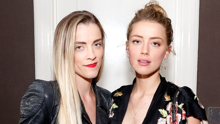 30801502 8526299 Amber Heard right in Los Angeles with assistant Kate James left a 1 1594832114048 91