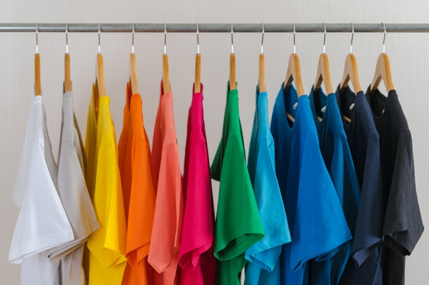 close up colorful t shirts hangers apparel background 51195 3842