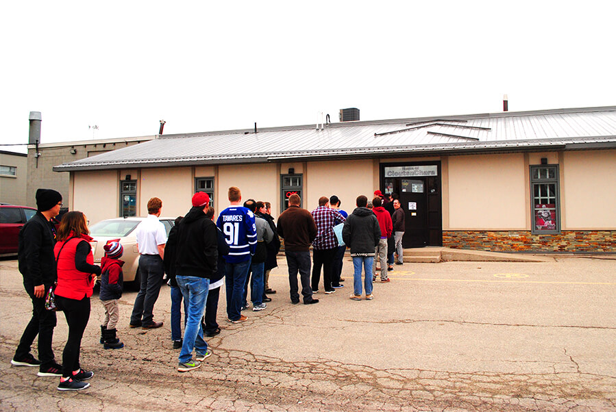 A line up outside the CloutsnChara store for the Steve Dangle book signing in April 2019.