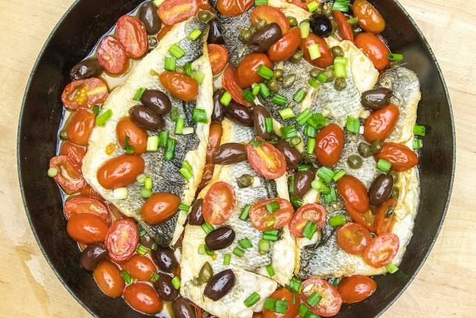 Branzino with tomato-olive sauce