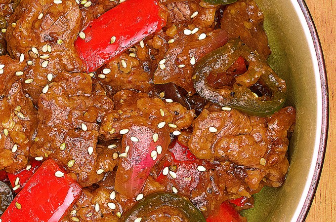 Tender marinated beef stir fry in a finger licking garlic-ginger sauce. This beef stir fry is one of the fastest and easiest recipes you'll make all year!