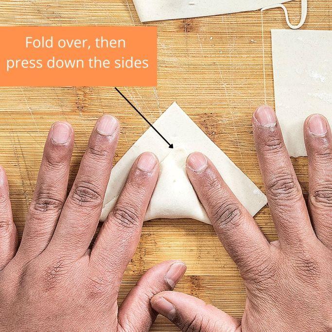 Step 2 - Folding a wonton.